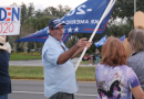 Rival Trump and Biden supporters hurl insults at each other outside rally – some resort to spitting