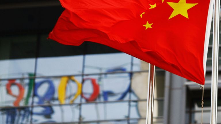 The Google logo is reflected in windows of the company's China head office as the Chinese national flag flies in the wind in Beijing on March 23, 2010 after the US web giant said it would no longer filter results and was redirecting mainland Chinese users to an uncensored site in Hong Kong -- effectively closing down the mainland site. Google's decision to effectively shut down its Chinese-language search engine is likely to stunt the development of the Internet in China and isolate local web us