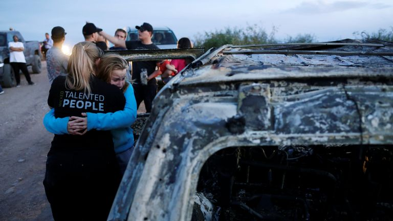 Relatives of slain members of Mexican-American families belonging to Mormon communities react next to the burnt wreckage of a vehicle where some of their relatives died, in Bavispe, Sonora state, Mexico November 5, 2019. REUTERS/Jose Luis Gonzalez TPX IMAGES OF THE DAY