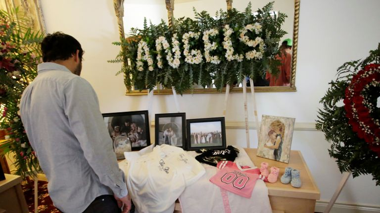 A person observes framed photographs of Rhonita Maria Miller and her four children, members of the Mexican-American Mormon community killed by unknown assailants, before her funeral in La Mora, in La Mora, Sonora state, Mexico November 7, 2019. REUTERS/Jose Luis Gonzalez