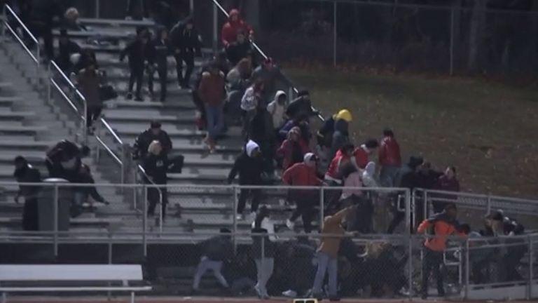 Spectators rush for cover as gunfire breaks out