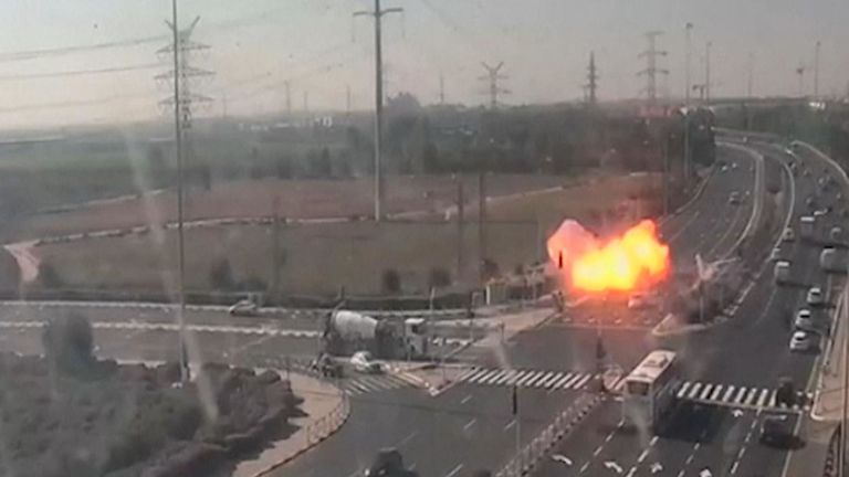 Video from a traffic camera in central Israel captured the moment on Tuesday when a rocket strikes a major highway only metres from several passing vehicles.