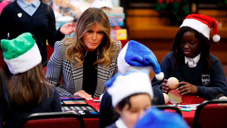 Melania Trump joins school children at the Salvation Army centre during her visit to London