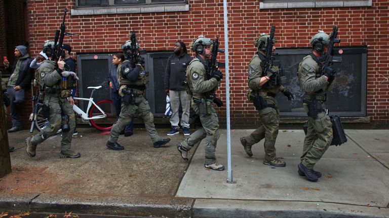 Officers arrive at the scene of the shooting in New Jersey