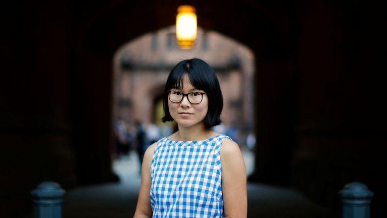 Hua Qu attends a vigil for Xiyue Wang