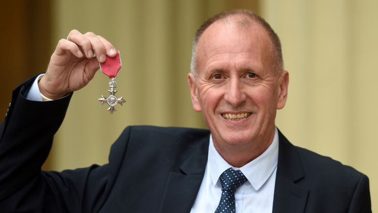 British rescue diver Vernon Unsworth poses with his medal after being appointed a Member of the Order of the British Empire (MBE) during an investiture ceremony at Buckingham Palace in London on June 12, 2019. - Unsworth was awarded an MBE for services to cave diving, after he helped to rescue a football team of 12 young boys trapped in the Tham Luand Nang Non cave in Chang Rai, Thailand. (Photo by David Mirzoeff / POOL / AFP) (Photo credit should read DAVID MIRZOEFF/AFP/Getty Images)