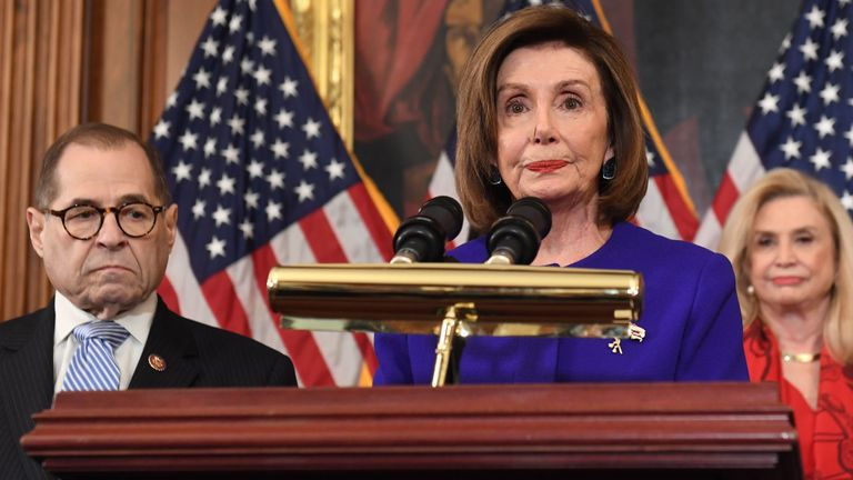Speaker of the House Nancy Pelosi (C), flanked by House Judiciary Chairman Jerry Nadler, (L) (D-NY) and House Committee on Oversight and Reform Chairwoman Carolyn Maloney (R) (D-NY), announces articles of impeachment against US President Donald Trump during a press conference at the US Capitol in Washington, DC, December 10, 2019. - Democrats listed abuse of power and obstruction of Congress. (Photo by SAUL LOEB / AFP) (Photo by SAUL LOEB/AFP via Getty Images)