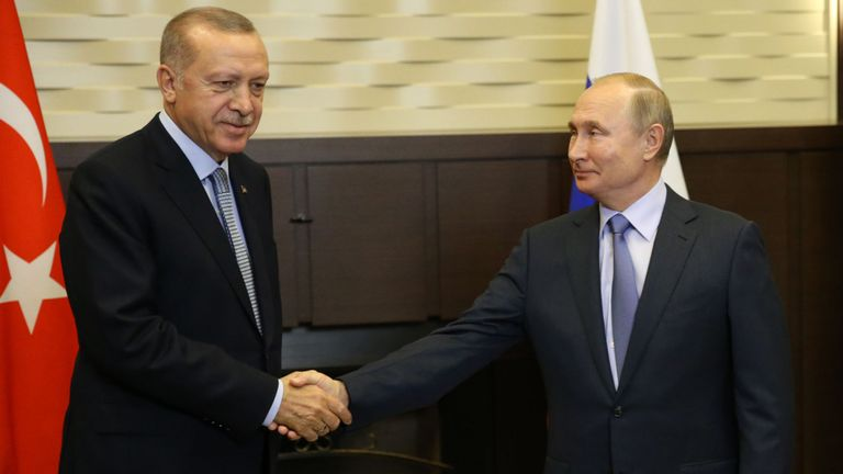 Turkish President Recep Tayyip Erdogan shakes hands with Russian leader Vladimir Putin at the end of the meeting